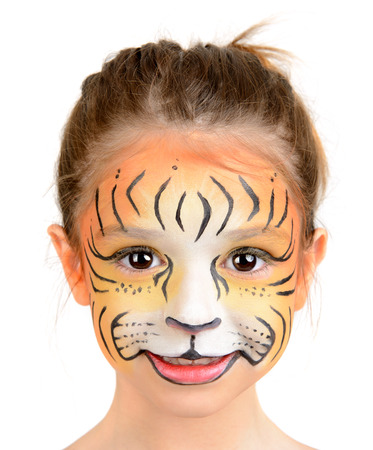 face painting: Beautiful young girl with face painted like a tiger Stock Photo