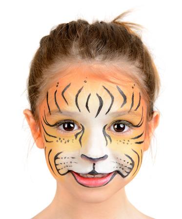 maquillaje infantil: Hermosa joven con la cara pintada como un tigre Foto de archivo