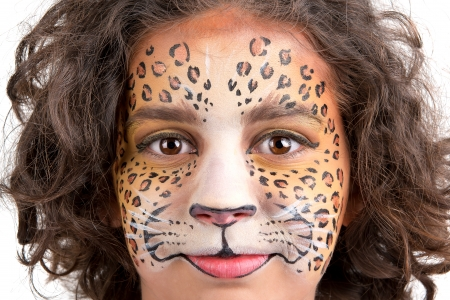 Beautiful young girl with face painted like a leopard Stock Photo - 24633142
