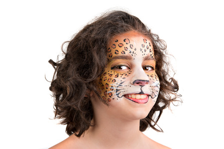 Beautiful young girl with face painted like a leopard Stock Photo - 24633158