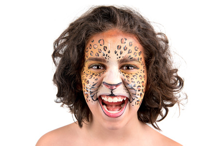 Beautiful young girl with face painted like a leopard Stock Photo - 24633159