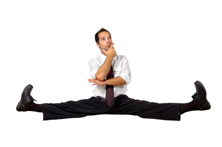 Businessman doing splits isolated in white photo