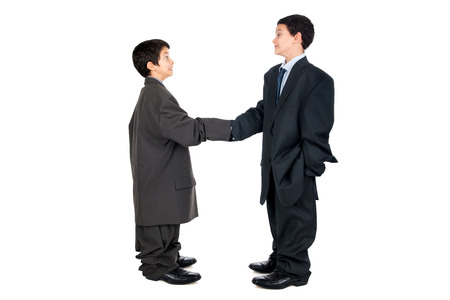 Young boys dressed with a big mans suit shaking hands photo