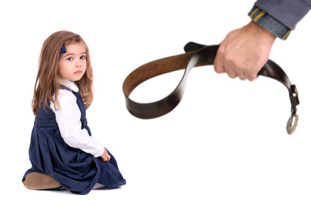 punishing: Young girl terrified od her fathers physical punishment with a belt Stock Photo