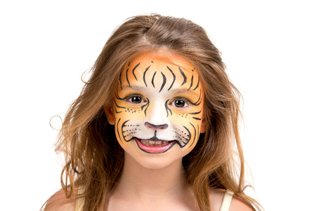 Beautiful young girl with face painted like a tiger Stock Photo