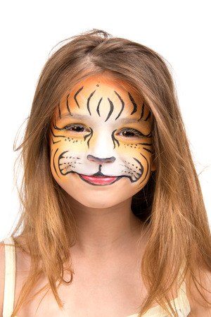 Beautiful young girl with face painted like a tiger photo