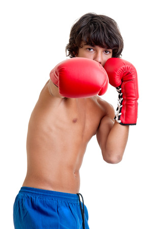 Young fighter posing with boxing gloves photo