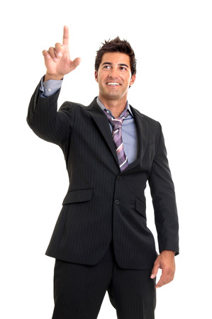 Young businessman pointing isolated in white photo