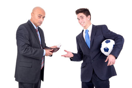 rival: Dispeased businessman paying a lost bet to a happy rival over a football game