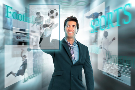 Businessman in a high-tech background with sports images photo