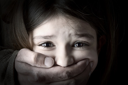 Scared young girl with an adult man s hand Stock Photo