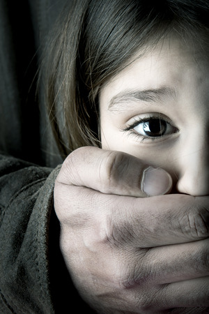 Scared young girl with an adult man s hand Stockfoto