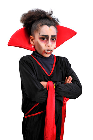 Young girl with vampire disguise photo