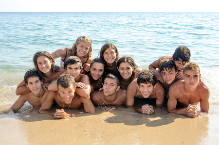 Group of happy teens at the beach photo