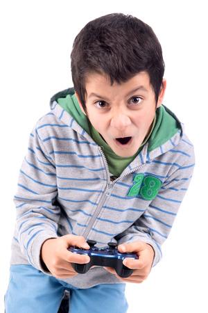 playing video games: Boy jugando juegos de video que hacen caras aislados en blanco Foto de archivo