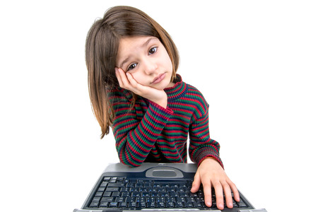 angry child: Desperate young girl with laptop computer Stock Photo