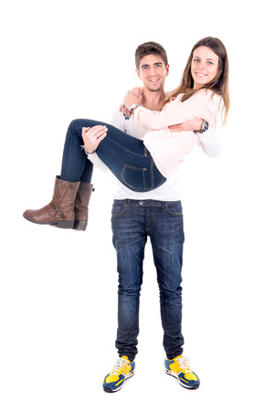 Young man carrying girlfriend isolated in white photo