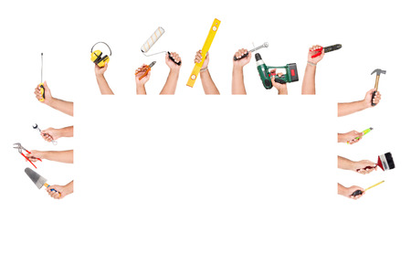 Several hands with construction tools Stock Photo