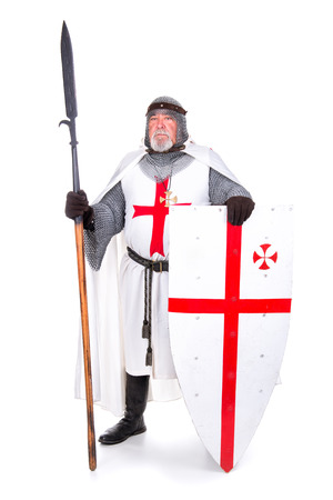 Knight Templar posing with shield and spear isolated in white photo