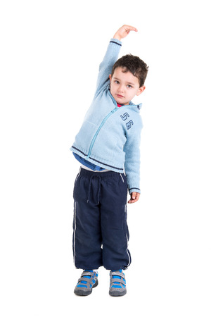 hight: Young boy measuring his hight isolated in white