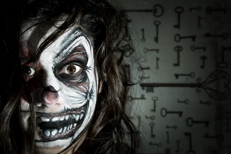 evil clown: Teenage girl with scary clown face painting