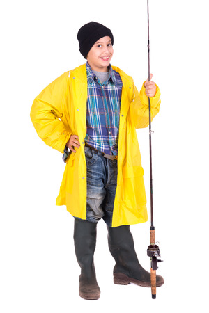 sportfishing: Young boy posing with fishing gear isolated in white