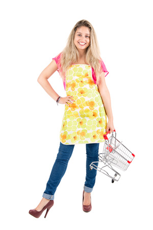 woman shopping cart: Beautiful woman with apron and shopping cart Stock Photo