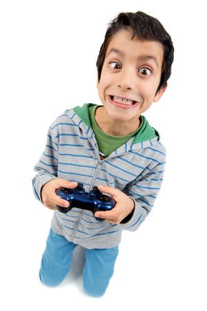 playing video games: Muchacho que juega juegos de video haciendo caras aislados en blanco