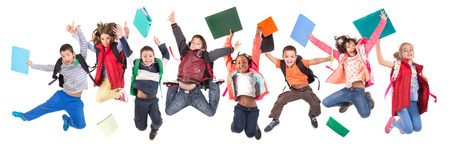 school child: Group of school children jumpng isolated in white