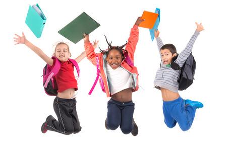 Groep schoolkinderen jumpng geïsoleerd in het wit Stockfoto - 33199758