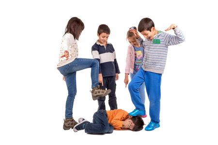 Group of children bullying an isolated child Standard-Bild