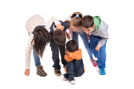 Group of children bullying an isolated child photo