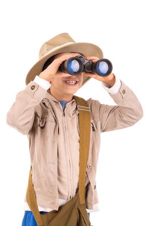 Young boy with binoculars playing Safari isolated in white Standard-Bild