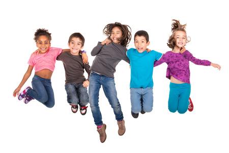 Groep kinderen jumpng geïsoleerd in het wit Stockfoto - 33834085