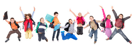 school friends: Group of school children jumping isolated in white