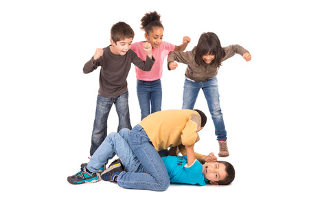 Boys fighting with other kids cheering isolated in white