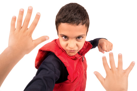 Young boy bullying another isolated in white Stock Photo