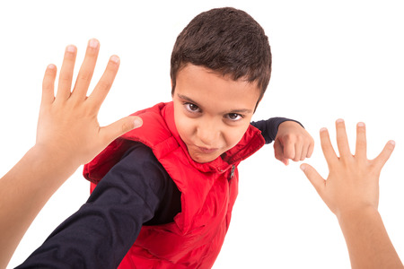 humiliation: Young boy bullying another isolated in white Stock Photo