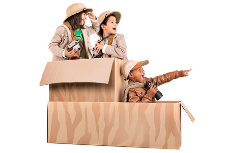 Children's group in a cardboard box playing safari Stockfoto