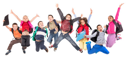 small group: Group of school children jumping isolated in white