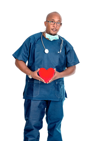 the descendant: African descendant doctor isolated against a white background with a red heart in his hands