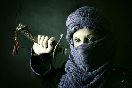 templars: Arabic Woman warrior portrait against a dark background