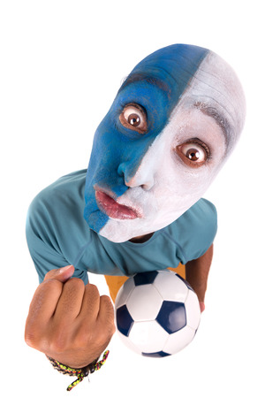 Football supporter with painted face with ball Stock Photo