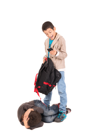 Boy bullying and stealing from a smaller one isolated in white