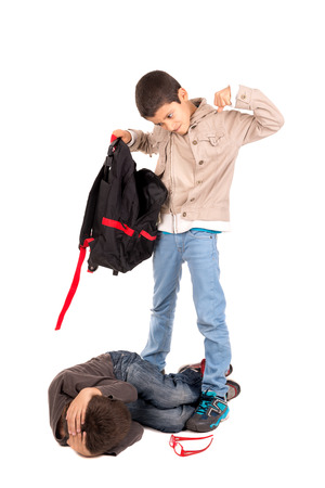 bullying: Boy bullying and stealing from a smaller one isolated in white