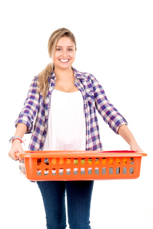houseclean: Positive young woman doing the laundry at home