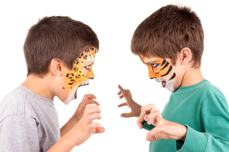 felines: Young boys with felines face-Paint roaring isolated in white Stock Photo