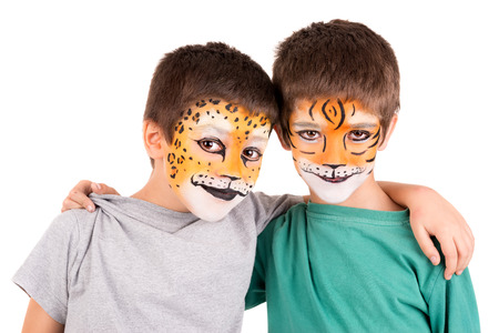 facial painting: Boys with face-painted like a leopard and tiger isolated in white