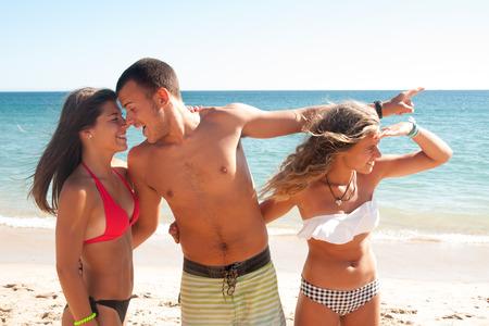 Teenage boy cheating girlfriend on the beach
