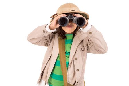 Young girl with binoculars playing Safari isolated in white